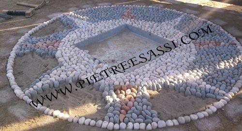 Mosaico a pavimento in ciottoli di fiume pietreesassi