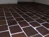 pavimento in piastrelle tranciate di porfido