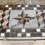 mosaico con ciottoli e cornice in pietra naturale