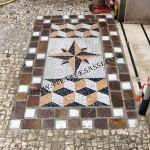 ingresso con mosaico in ciottoli